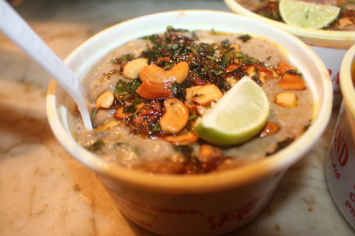 haleem topped with lemon and nuts