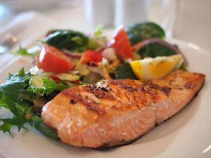 cooked salmon fish with toppings