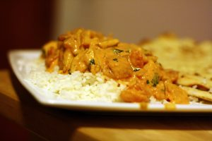 butter chicken with rice in a plate