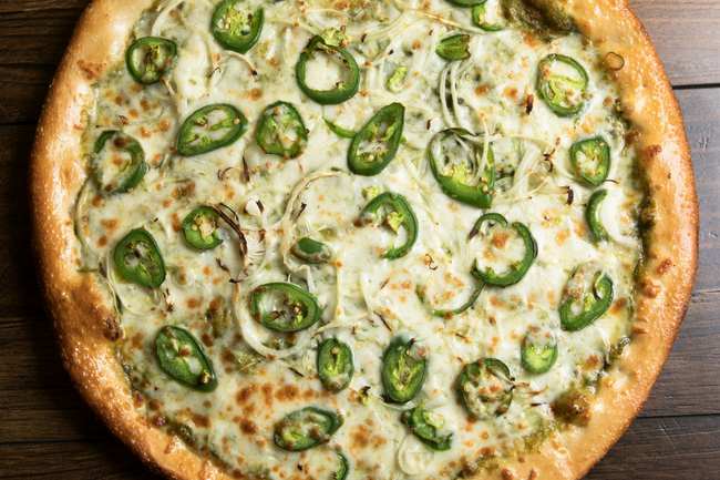 pizza with green toopings